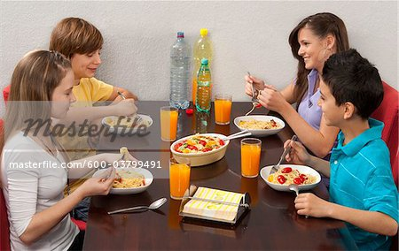 Children Eating Pasta Stock Photo - Premium Royalty-Free, Image code: 600-03799491