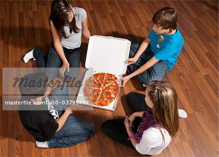 Children Eating Pizza Stock Photo - Premium Royalty-Free, Image code: 600-03799497