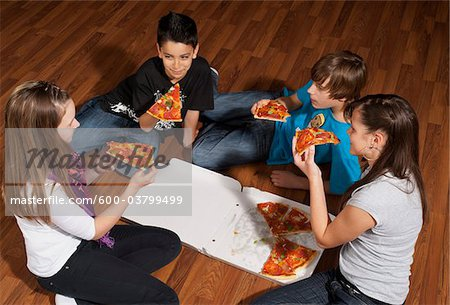 Children Eating Pizza Stock Photo - Premium Royalty-Free, Image code: 600-03799499