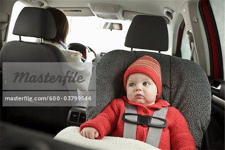 Baby in Car Seat with Mother Driving Stock Photo - Premium Royalty-Free, Image code: 600-03799544