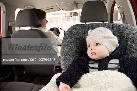Baby in Car Seat with Mother Driving Stock Photo - Premium Royalty-Free, Image code: 600-03799545