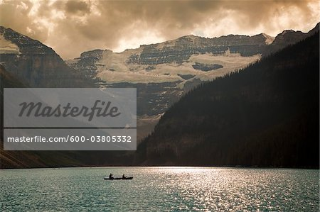 Mount Victoria and Lake Louise with Canoeists, Banff National Park, Alberta, Canada Stock Photo - Premium Royalty-Free, Image code: 600-03805332