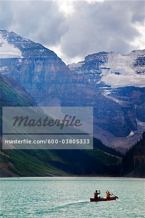 Canoeists on Lake Louise with Mounts Lefroy and Victoria, Banff National Park, Alberta, Canada Stock Photo - Premium Royalty-Free, Image code: 600-03805333