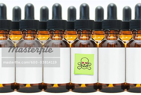 Rows of Eye Dropper Bottles with One Marked Poison Stock Photo - Premium Royalty-Free, Image code: 600-03814119