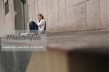 Young Woman Outdoors Stock Photo - Premium Royalty-Free, Image code: 600-03814781