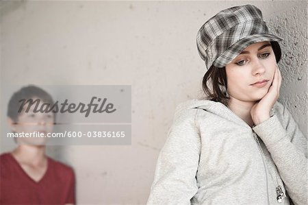Girl and Boy Leaning on Wall Stock Photo - Premium Royalty-Free, Image code: 600-03836165