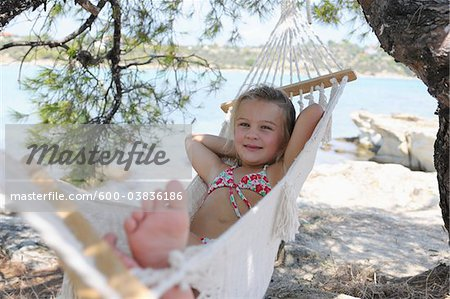 Girl in Hammock Stock Photo - Premium Royalty-Free, Image code: 600-03836186