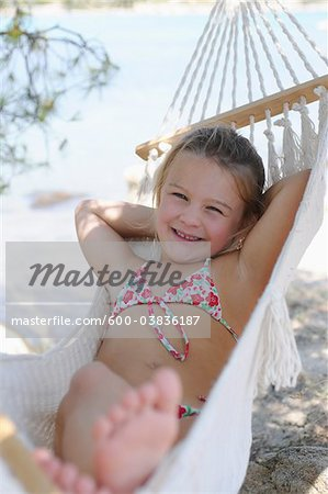 Girl in Hammock Stock Photo - Premium Royalty-Free, Image code: 600-03836187