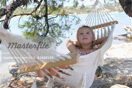 Girl in Hammock Stock Photo - Premium Royalty-Free, Image code: 600-03836188