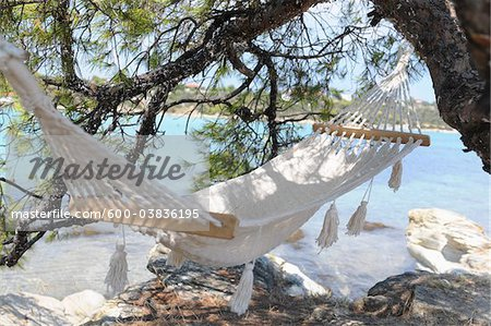 Hammock by Water Stock Photo - Premium Royalty-Free, Image code: 600-03836195