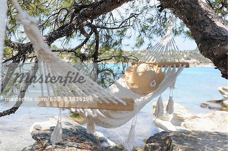 Hammock by Water Stock Photo - Premium Royalty-Free, Image code: 600-03836196
