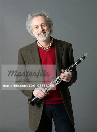 Man with Clarinet Stock Photo - Premium Royalty-Free, Image code: 600-03836288