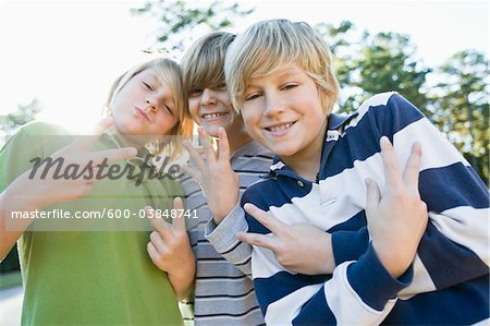 Boys Making Hand Gestures Stock Photo - Premium Royalty-Free, Image code: 600-03848741