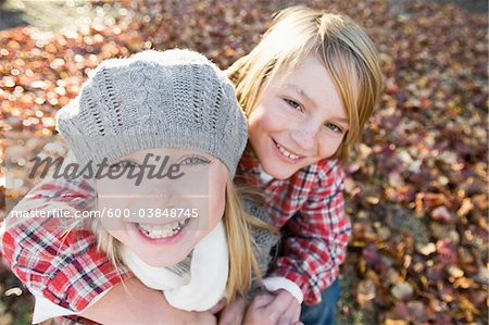 Portrait of Boy and Girl in Autumn Stock Photo - Premium Royalty-Free, Image code: 600-03848745