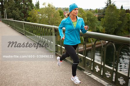 Woman Jogging across Bridge, Seattle, Washington, USA Stock Photo - Premium Royalty-Free, Image code: 600-03849022