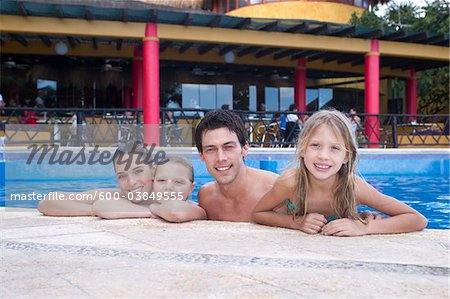 Family in Swimming Pool, Reef Playacar Resort and Spa, Playa del Carmen, Mexico Stock Photo - Premium Royalty-Free, Image code: 600-03849555