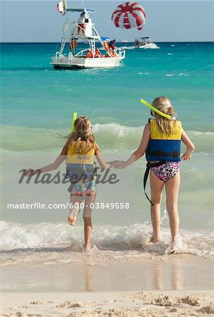 Girls in Snorkeling Gear on Beach, Reef Playacar Resort and Spa, Playa del Carmen, Mexico Stock Photo - Premium Royalty-Free, Image code: 600-03849558