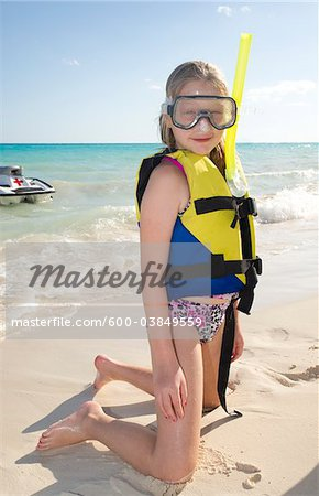 Girl in Snorkeling Gear on Beach, Reef Playacar Resort and Spa, Playa del Carmen, Mexico Stock Photo - Premium Royalty-Free, Image code: 600-03849559