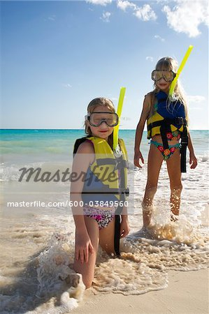 Girls in Snorkeling Gear on Beach, Reef Playacar Resort and Spa, Playa del Carmen, Mexico Stock Photo - Premium Royalty-Free, Image code: 600-03849560