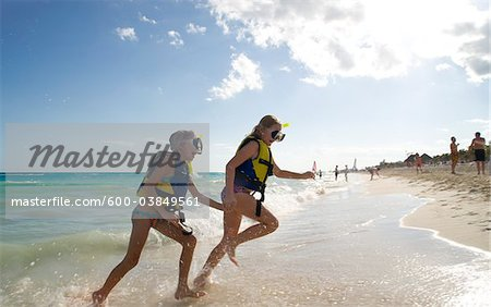 Girls in Snorkeling Gear on Beach, Reef Playacar Resort and Spa, Playa del Carmen, Mexico Stock Photo - Premium Royalty-Free, Image code: 600-03849561