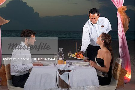 Couple Dining on Beach, Reef Playacar Resort and Spa, Playa del Carmen, Mexico Stock Photo - Premium Royalty-Free, Image code: 600-03849564
