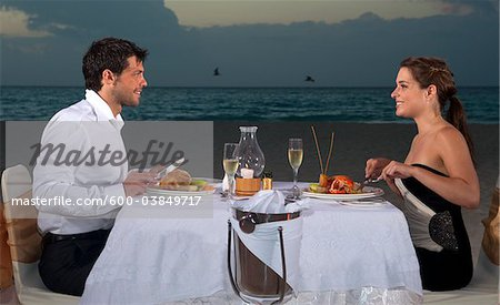 Couple Dining on Beach, Reef Playacar Resort and Spa, Playa del Carmen, Mexico Stock Photo - Premium Royalty-Free, Image code: 600-03849717