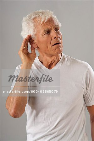 Man with Hand to Ear Stock Photo - Premium Royalty-Free, Image code: 600-03865079