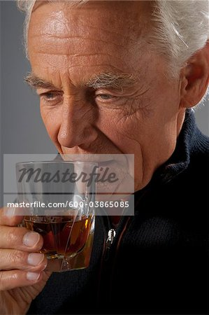 Man Drinking Alcohol Stock Photo - Premium Royalty-Free, Image code: 600-03865085