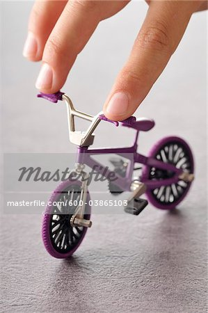 Fingers Touching Miniature Bike Stock Photo - Premium Royalty-Free, Image code: 600-03865103