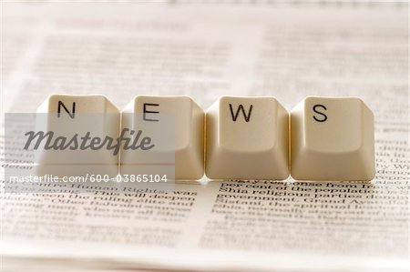 Computer Keys Spelling News Stock Photo - Premium Royalty-Free, Image code: 600-03865104