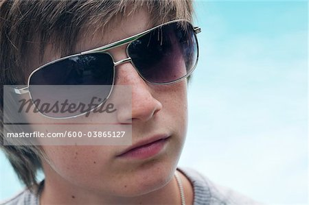 Portrait of Boy wearing Sunglasses Stock Photo - Premium Royalty-Free, Image code: 600-03865127
