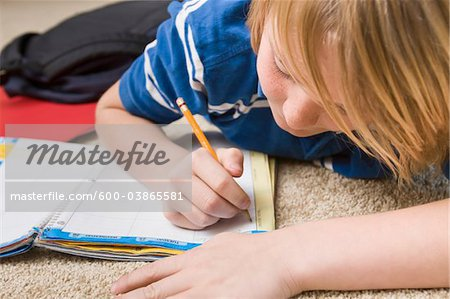 Boy Doing School Work, Tallahassee, Florida, USA Stock Photo - Premium Royalty-Free, Image code: 600-03865581