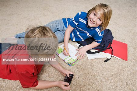 Boys Doing School Work and Using Cellular Telephone, Tallahassee, Florida, USA Stock Photo - Premium Royalty-Free, Image code: 600-03865583