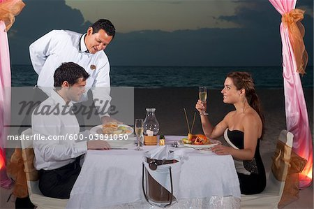 Couple Dining on Beach, Reef Playacar Resort and Spa, Playa del Carmen, Mexico Stock Photo - Premium Royalty-Free, Image code: 600-03891050