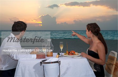 Couple Dining on Beach, Reef Playacar Resort and Spa, Playa del Carmen, Mexico Stock Photo - Premium Royalty-Free, Image code: 600-03891052