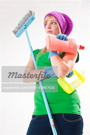 Portrait of Young Woman with Cleaning Supplies Stock Photo - Premium Royalty-Free, Image code: 600-03907115