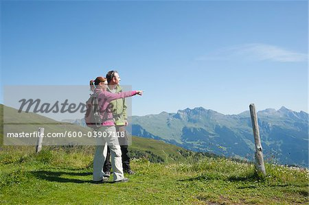 Couple Looking at View, Bernese Oberland, Switzerland Stock Photo - Premium Royalty-Free, Image code: 600-03907118