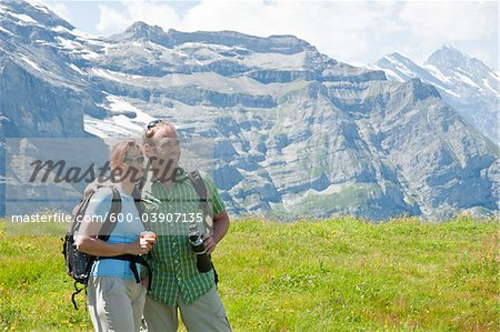 Couple Looking at View, Bernese Oberland, Switzerland Stock Photo - Premium Royalty-Free, Image code: 600-03907135