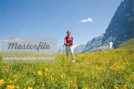 Woman Hiking, Berense Oberland, Eiger Peak, North Face, Switzerland Stock Photo - Premium Royalty-Free, Image code: 600-03907139