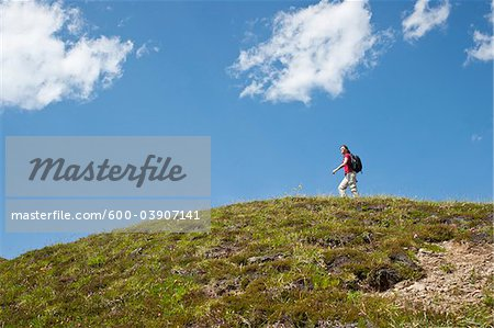 Woman Hiking on Mountain Top, Bernese Oberland, Switzerland Stock Photo - Premium Royalty-Free, Image code: 600-03907141