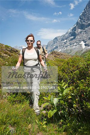Couple Hiking using Walking Sticks, Bernese Oberland, Switzerland