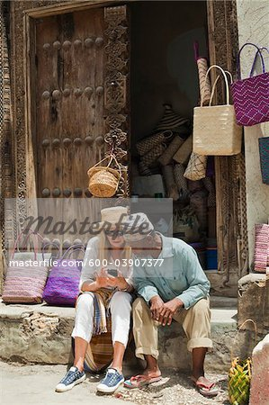 Basket Seller with Tourist, Stone Town, Unguja, Zanzibar, Tanzania Stock Photo - Premium Royalty-Free, Image code: 600-03907377
