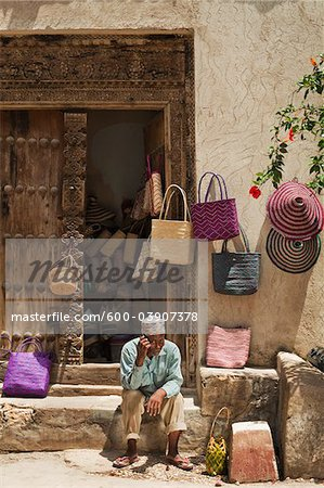 Basket Seller Using Cell Phone, Stone Town, Unguja, Zanzibar, Tanzania Stock Photo - Premium Royalty-Free, Image code: 600-03907378