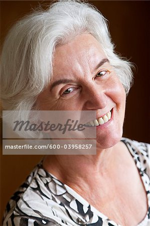 Close-up Portrait of Woman Stock Photo - Premium Royalty-Free, Image code: 600-03958257