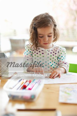 Girl Colouring at Kitchen Table Stock Photo - Premium Royalty-Free, Image code: 600-04163459