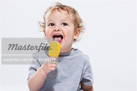 Portrait of Boy Eating Ice Cream Treat Stock Photo - Premium Royalty-Free, Image code: 600-04183473