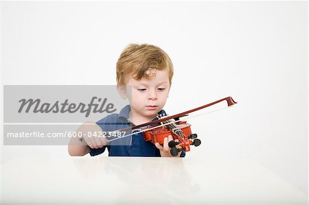 Young Boy Playing Violin
