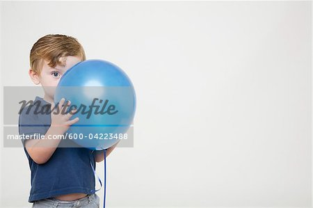 Young Boy Playing with Balloon Stock Photo - Premium Royalty-Free, Image code: 600-04223488
