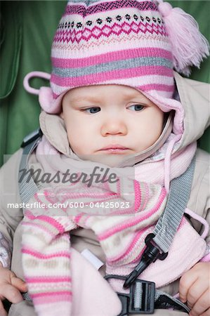 Close-up of Baby Girl Sitting in Car Seat wearing Winter Clothing Stock Photo - Premium Royalty-Free, Image code: 600-04425023