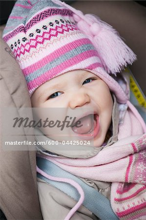 Close-up of Baby Girl Sitting in Car Seat wearing Winter Clothing Stock Photo - Premium Royalty-Free, Image code: 600-04425024